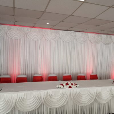 Drape backdrop top table hire